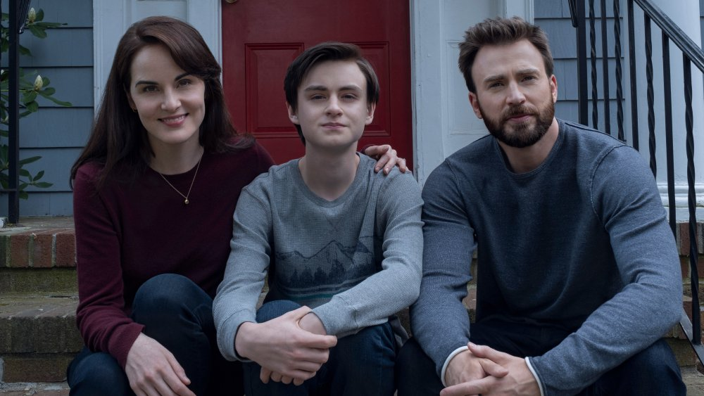 Chris Evans as Andy Barber, Michelle Dockery as Laurie Barber, and Jaeden Martell as Jacob Barber on Defending Jacob