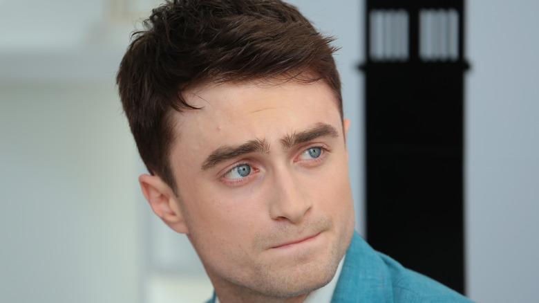 Daniel Radcliffe glances to side