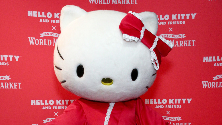 An actress dressed as Hello Kitty poses at a Cost Plus World Market event