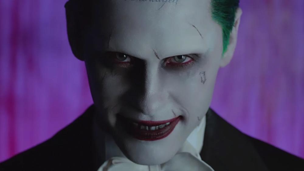 Joker in tuxedo purple backdrop