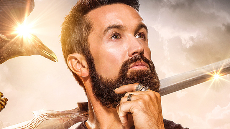 Rob McElhenney in close-up with sword