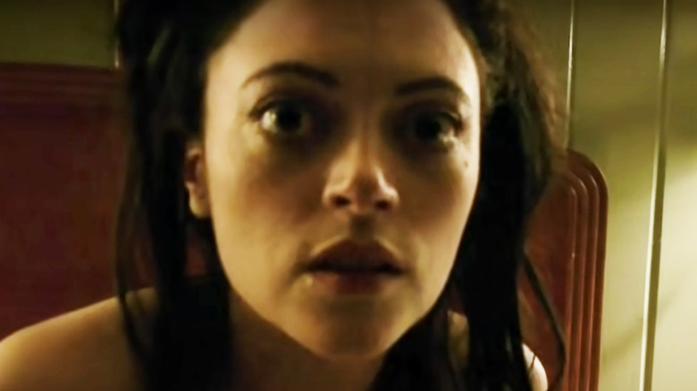 V/H/S Lily looks at camera