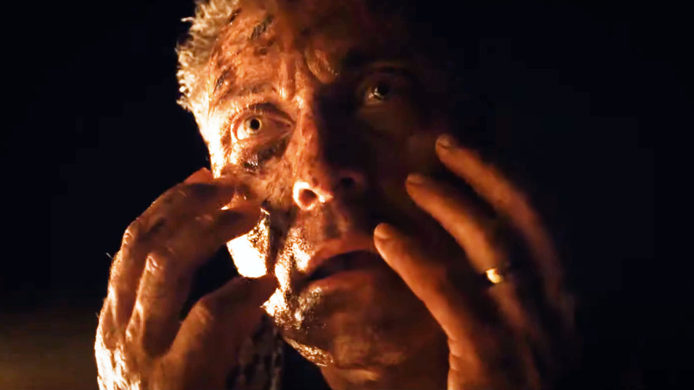 Man with hands by his face from Old trailer