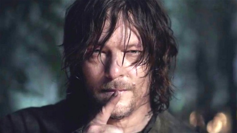 Daryl Dixon with a finger to his mouth