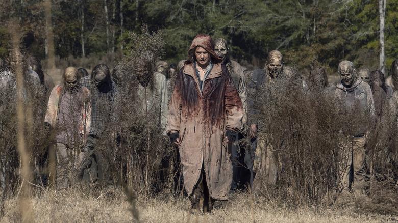 Carol (Martina McBride) walks through a horde of walkers on The Walking Dead