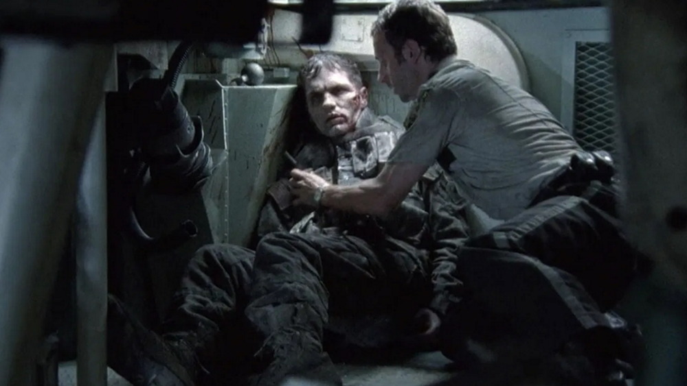 Rick Grimes (Andrew Lincoln) and a zombie (Sam Witwer) in The Walking Dead