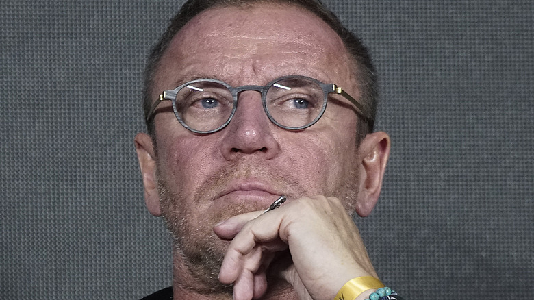Renny Harlin glasses scratches his chin