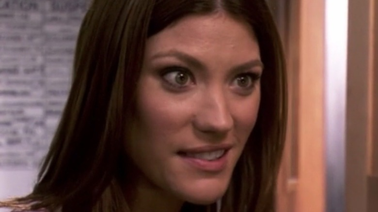 Debra Morgan smirking with eyebrows raised
