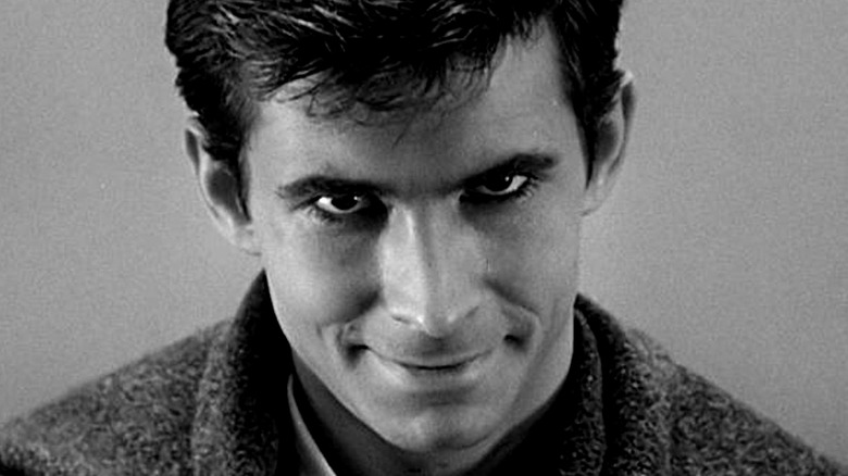 Norman Bates smiling dementedly