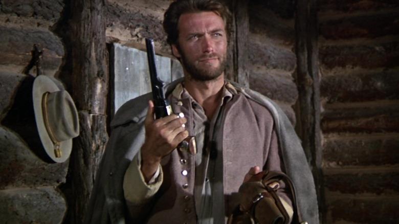 Clint Eastwood holds gun