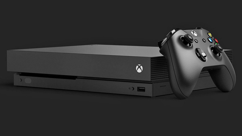 The Xbox One against a black backdrop
