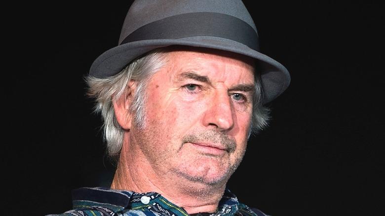John Jarratt from Wolf Creek in a hat