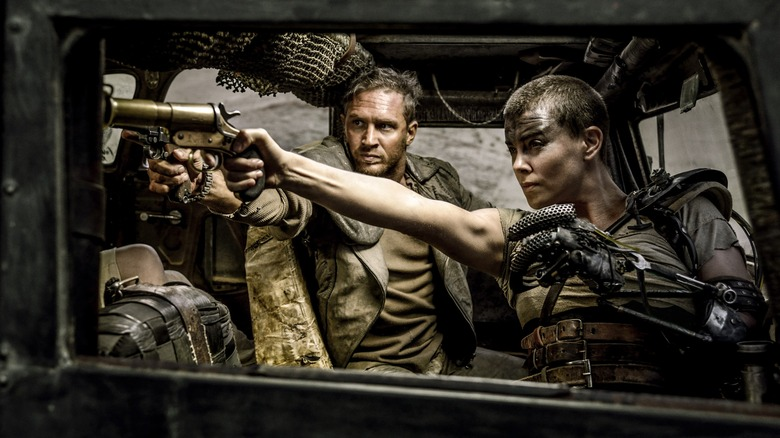 Charlize Theron as Furiosa and Tom Hardy as Max in Mad Max: Fury Road