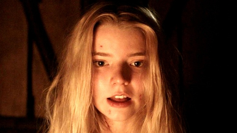 Anya Taylor-Joy in front of the fire in The Witch