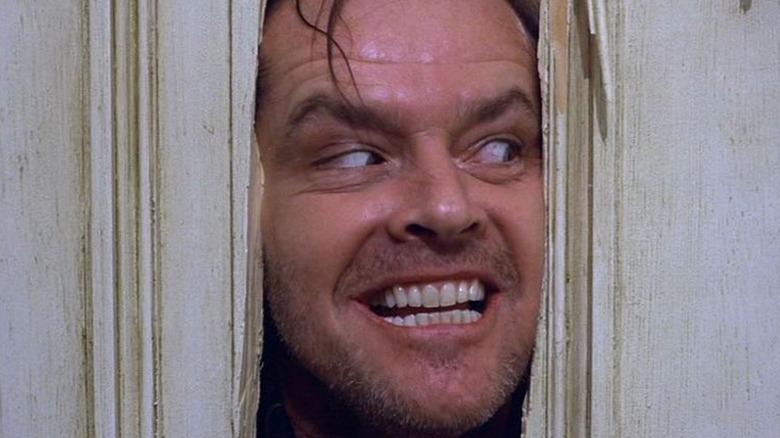 Jack peering through the door
