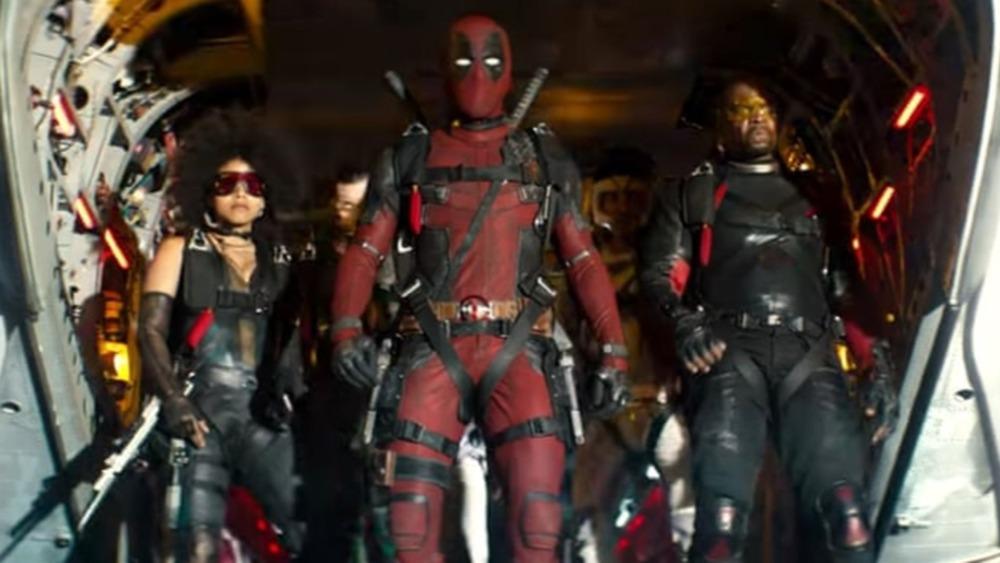 Domino, Deadpool, and Bedlam preparing to parachute
