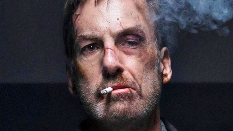 Hutch Mansell smoking a cigarette