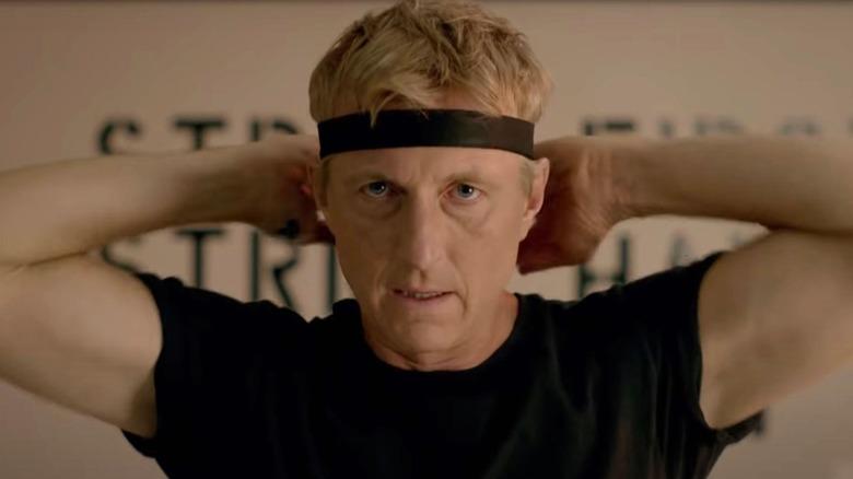 Johnny Lawrence ties headband