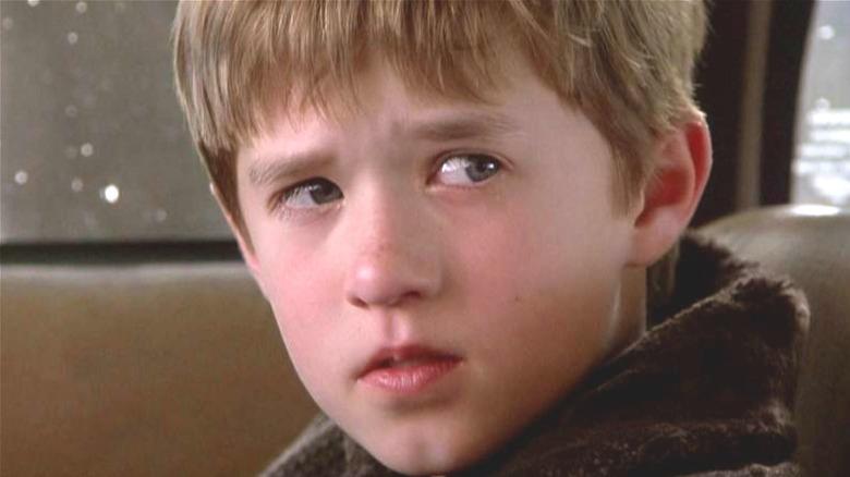 Haley Joel Osment looking somber
