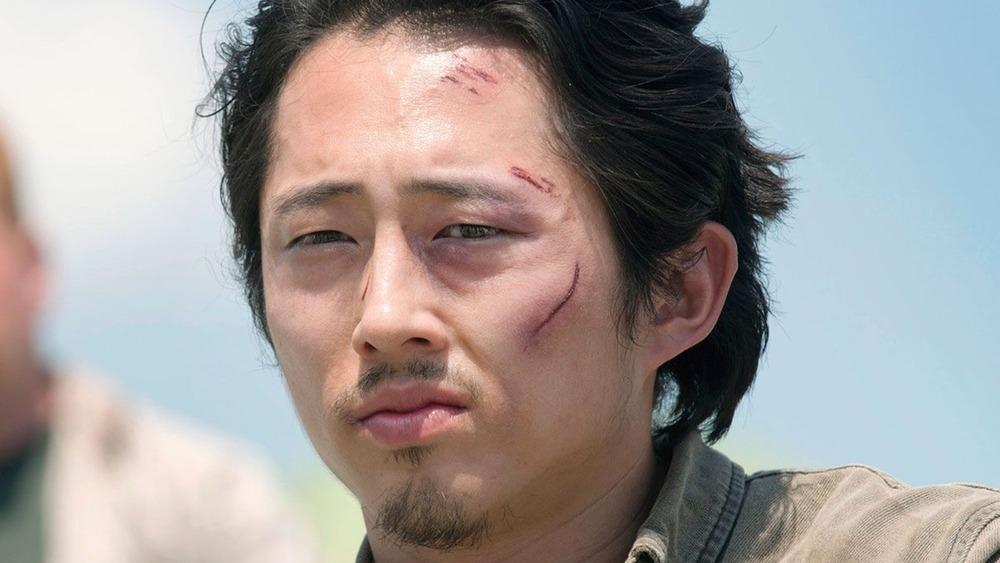 Glenn Rhee cuts on face