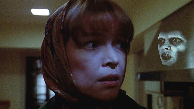 Ellen Burstyn looking around in fear