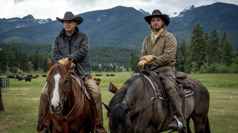 John Dutton (Kevin Costner) and Kayce Dutton (Luke Grimes) ride horses on Yellowstone