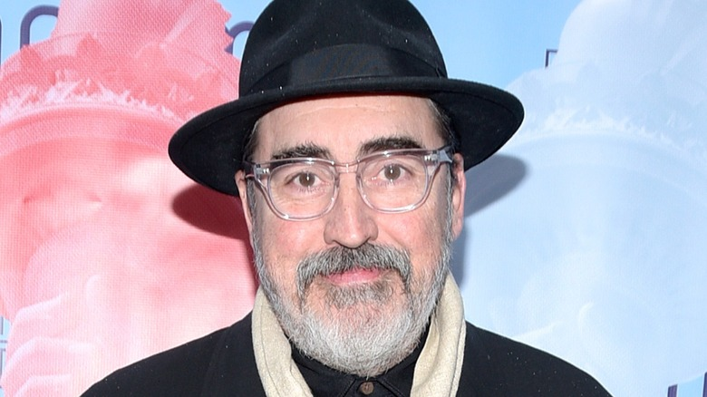 Alfred Molina wearing hat
