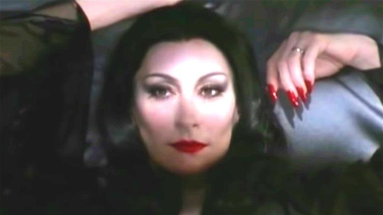 Anjelica Huston Morticia Addams lying down