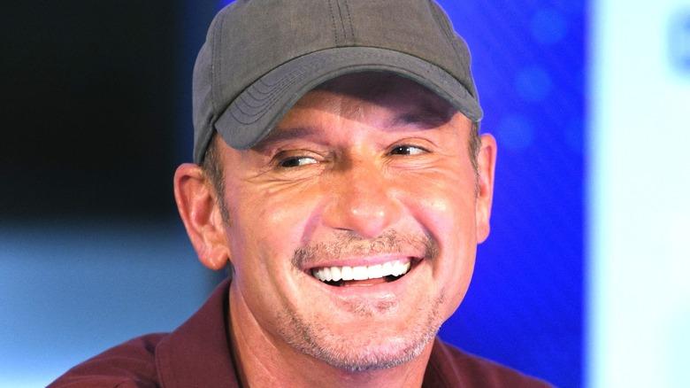 Tim McGraw baseball cap smile