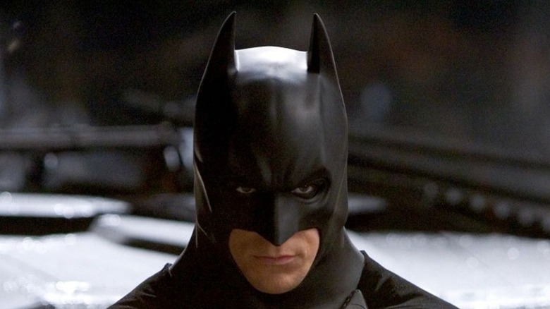 Batman prepares to enter his Batmobile