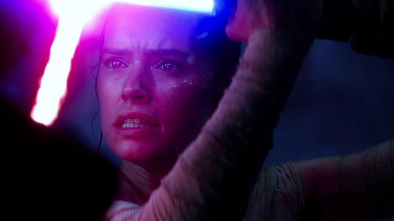 "Rey (Daisy Ridley) locked in a lightsaber battle in ""Star Wars: The Force Awakens"""