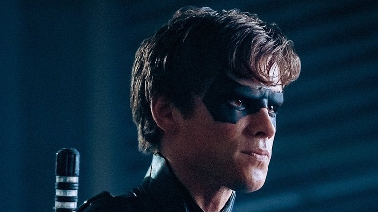 Nightwing pursing his lips