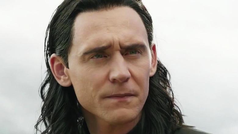 Loki looking concerned at Odin