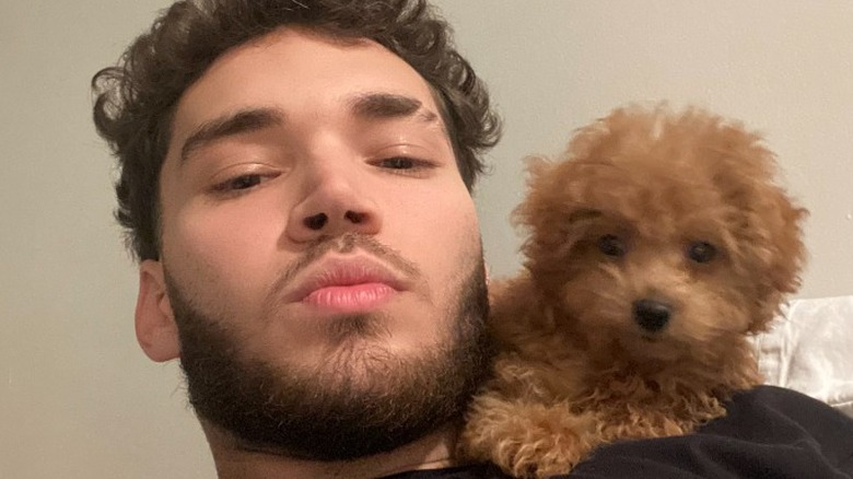 Adin Ross and his dog