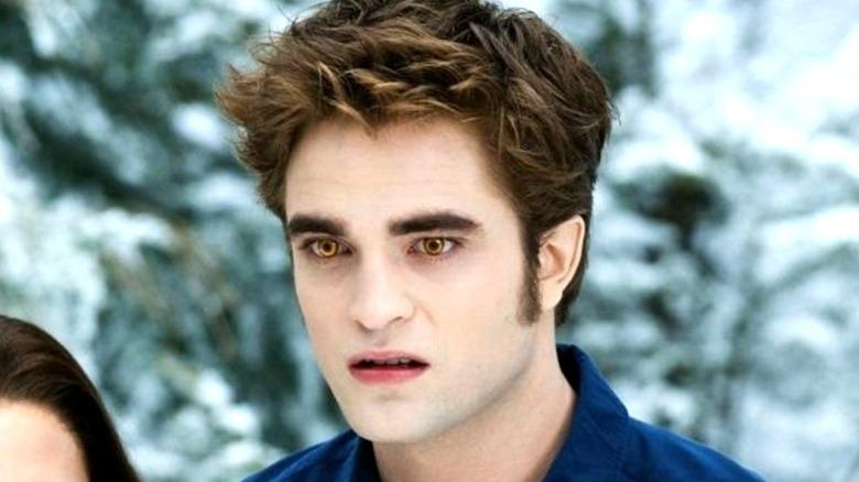 Robert Pattinson looking on