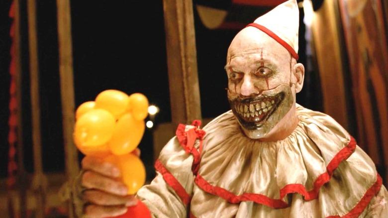 John Carroll Lynch as Twisty on American Horror Story
