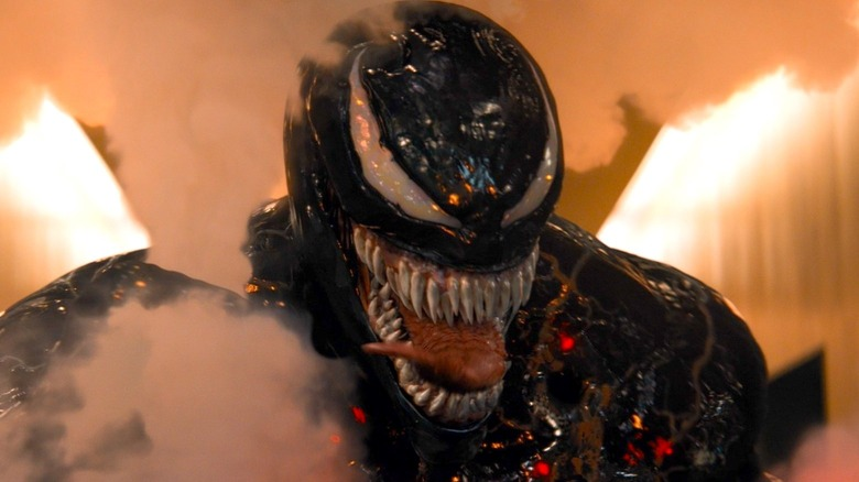 Venom grinning and sticking his tongue out