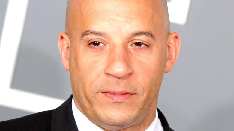 Vin Diesel posting in a suit