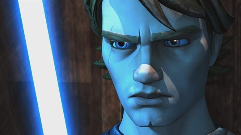 Anakin bathed in blue lightsaber light