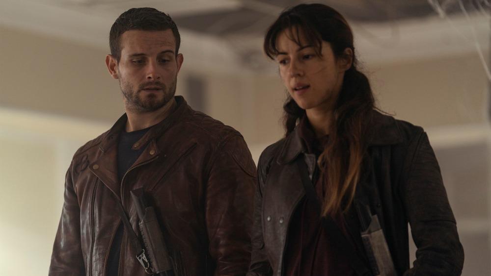 Annet Mahendru as Huck and Nico Tortorella as Felix debate Silas on The Walking Dead: World Beyond
