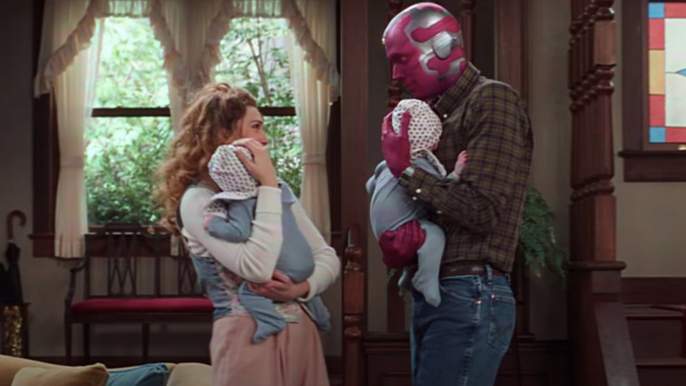 Wanda and Vision holding Billy and Tommy