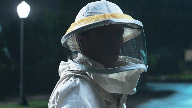 The beekeeper on a dark street