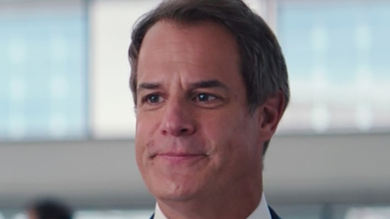 Director Hayward smirking