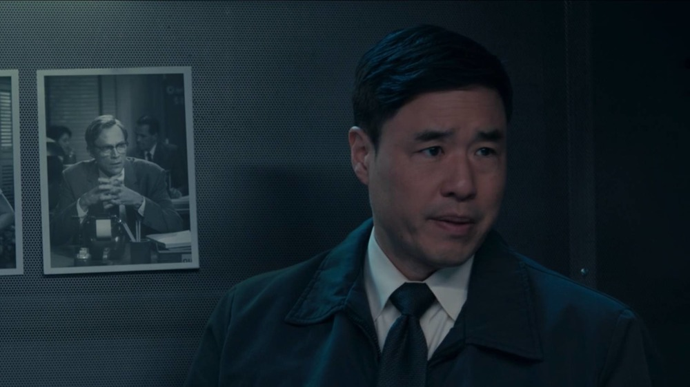 Jimmy Woo stands in front of a picture of Vision