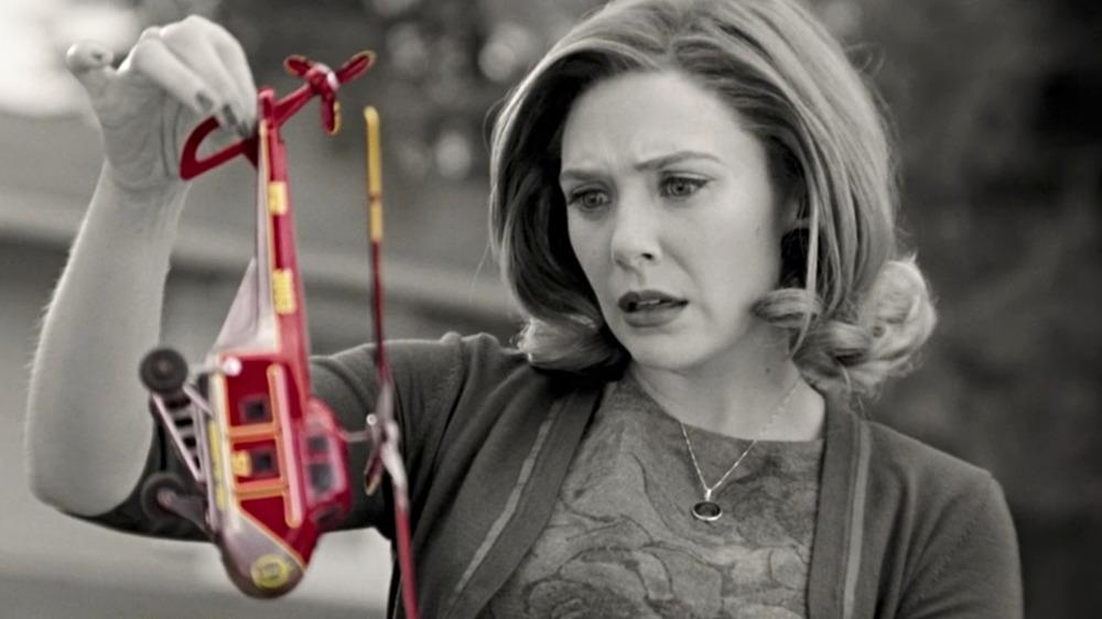 Wanda holds a toy helicopter on WandaVision