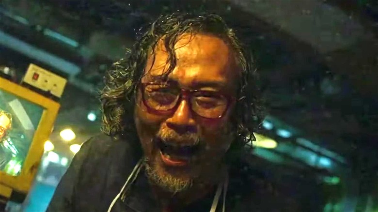 sweaty doctor with glasses laughing in V/H/S/94