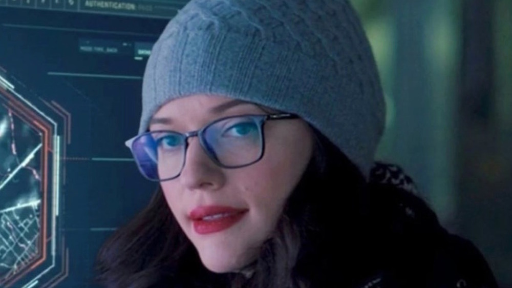 Dr. Darcy Lewis in glasses and hat