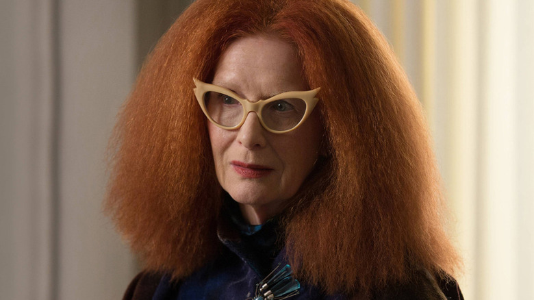 Myrtle Snow wears chic glasses