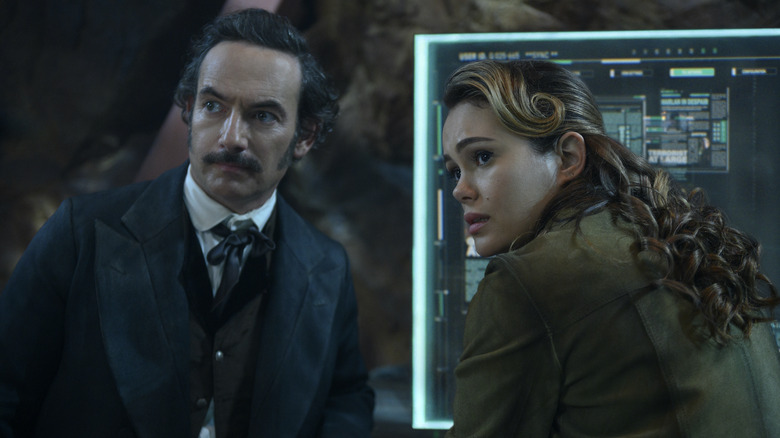 Chris Conner as Poe and Dina Shihabi as Dig 301 on Altered Carbon