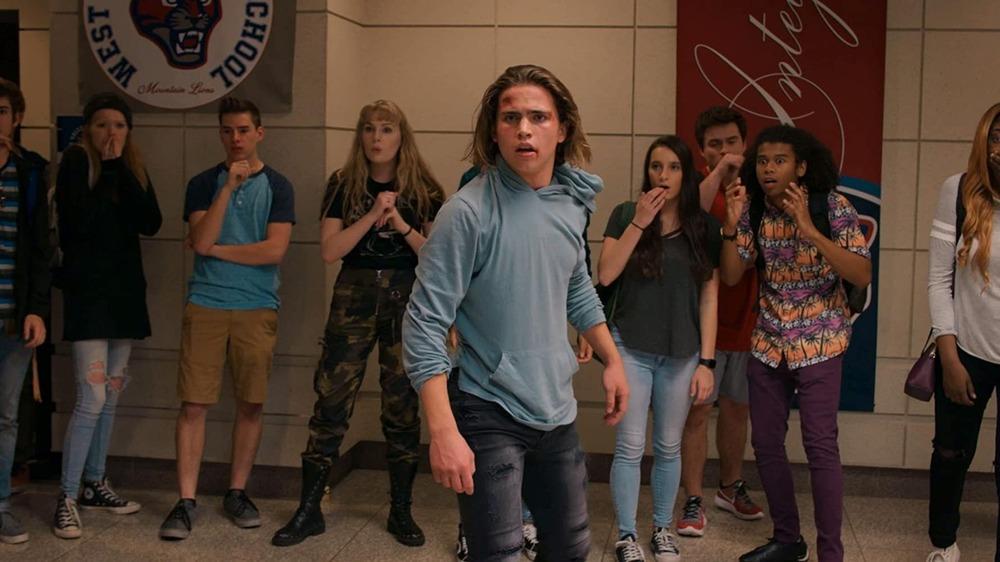 Tanner Buchanan as Robby Keene on Cobra Kai